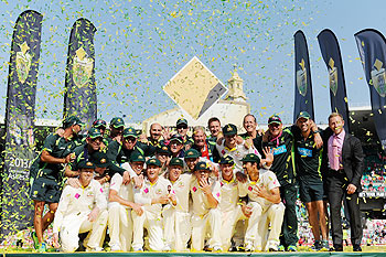 The Australian team celebrates after winning the Ashes series on Sunday