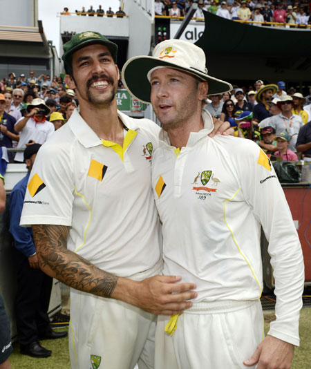 Australia's Mitchell Johnson (left) celebrates with captain Michael Clarke