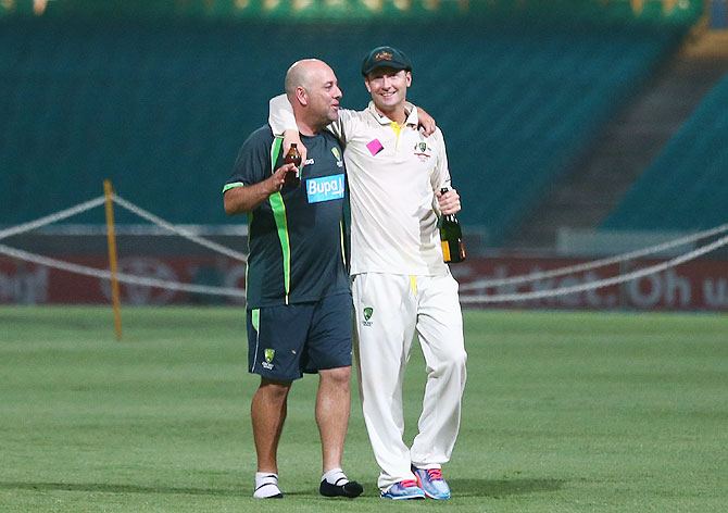 Darren Lehmann, coach of Australia, and Michael Clarke of Australia talk on the pitch at midnight after the third Test on Sunday