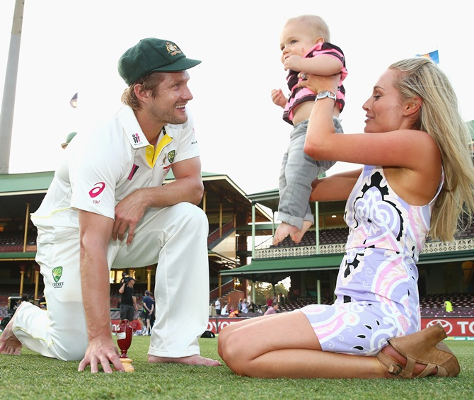Shane Watson of Australia, his son and wife pose with the urn