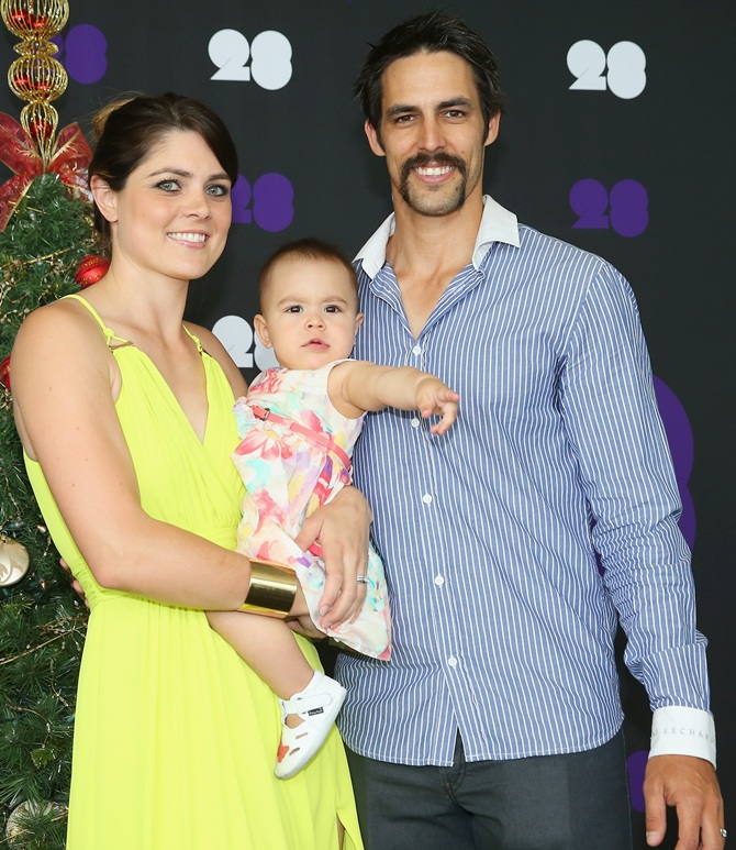 Mitchell Johnson of Australia poses with his wife Jessica Bratich-Johnson and daughter Rubika
