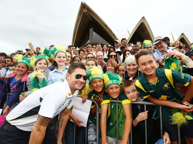 Michael Clarke poses with the cheering fans