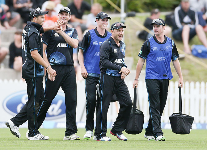 New Zealand's Brendon McCullum (centre) celebrates with teammates after a wicket