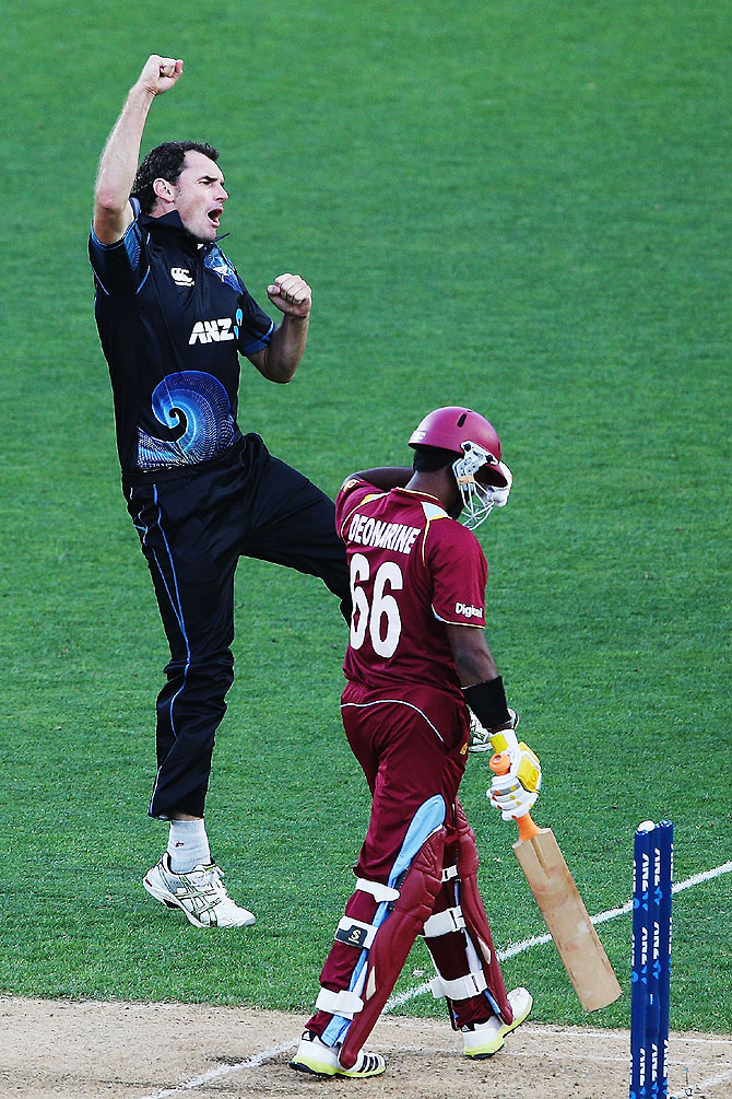 Kyle Mills of New Zealand celebrates the wicket of Narsingh Deonarine of the West Indies