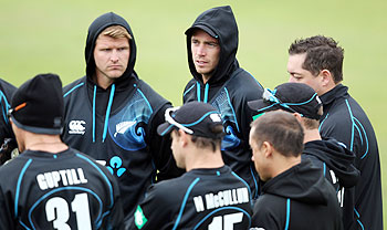 Tim Southee of New Zealand listens intently during a team meeting