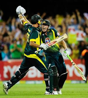 James Faulkner and Clint McKay celebrate after Australia beat England in the second ODI.