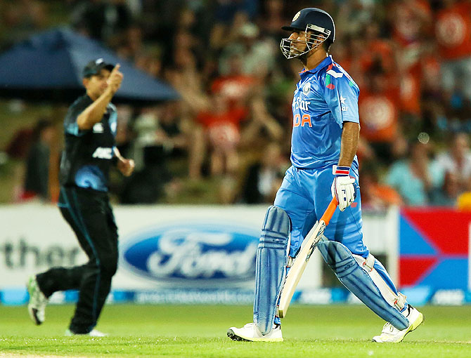 MS Dhoni of India leaves the field after being dismissed during the first One Day International match against New Zealand at McLean Park in