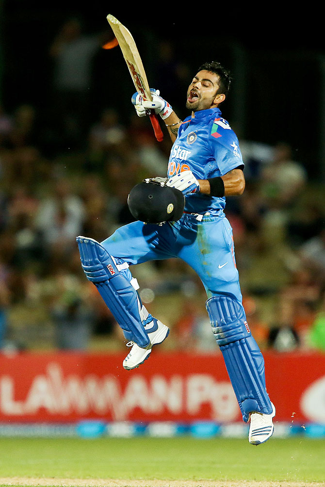Virat Kohli of India celebrates his century on Sunday