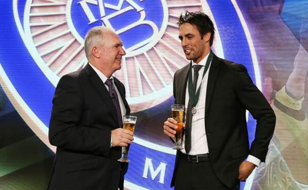 Mitchell Johnson talks with Allan Border on stage after winning the Allan Border medal