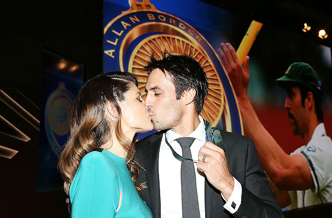 Mitchell Johnson is kissed by his wife Jessica Bratich-Johnson after winning the Allan Border Medal during the 2014 Allan Border Medal at Doltone House in Sydney on Monday