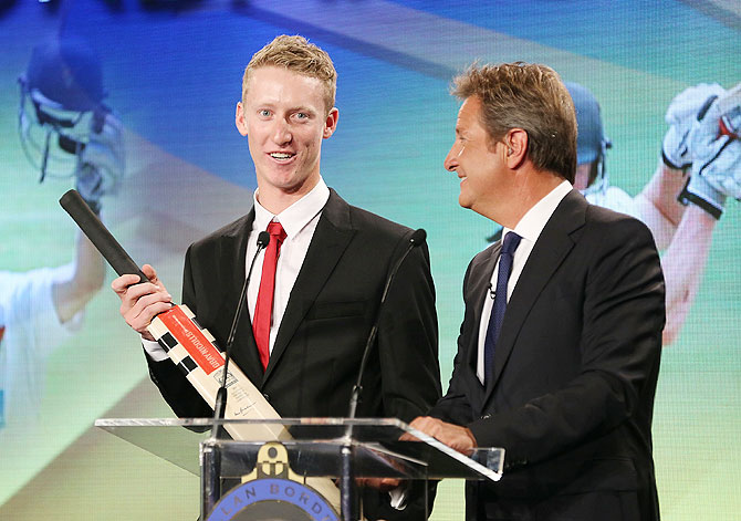 Jordan Silk speaks on stage after being awarded the Bradman Young Cricketer of the Year award during the 2014 Allan Border Medal night on Monday