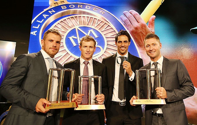 Aaron Finch, George Bailey, Mitchell Johnson and Michael Clarke pose with their awards during the 2014 Allan Border Medal night on Monday