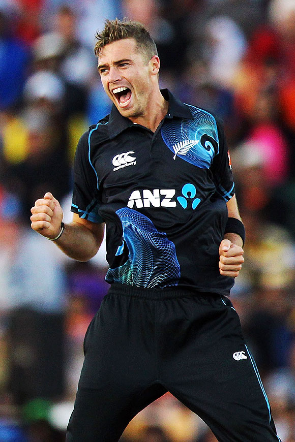 Tim Southee of New Zealand celebrates after taking the wicket of Rohit Sharma