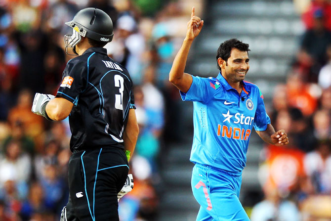 Mohammed Shami of India celebrates after taking the wicket of Ross Taylor of New Zealand
