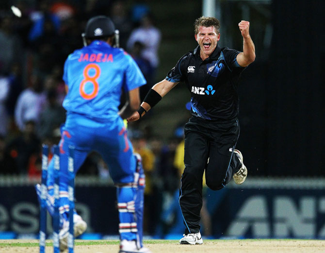 Corey Anderson of New Zealand celebrates after taking the wicket of Ravindra Jadeja of India