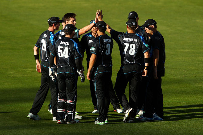 Zealand team celebrates a wicket