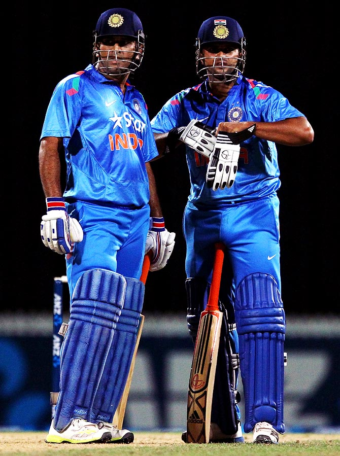 Suresh Raina (right) with Mahendra Singh Dhoni