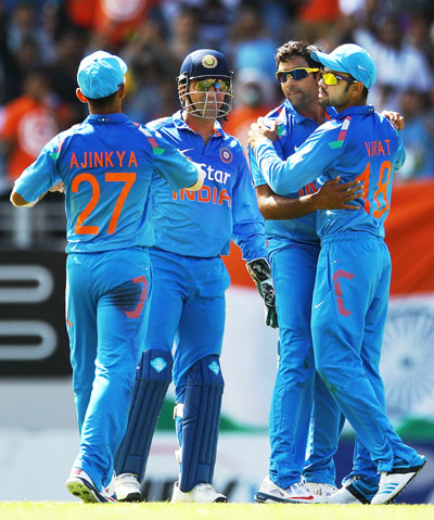 MS Dhoni of India celebrates with teammates Ravichandran Ashwin, Virat Kohli and Ajinkya Rahane