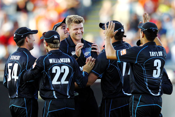 Corey Anderson of New Zealand celebrates after taking the wicket of Ajinkya Rahane of India