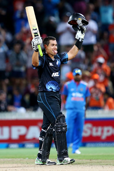 Ross Taylor celebrates after completing his hundred