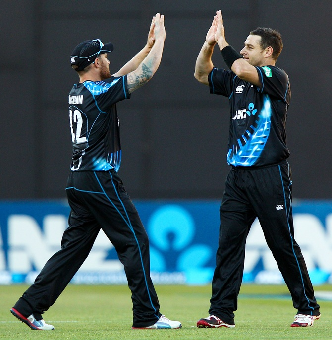 Brendon McCullum (left) and Nathan McCullum of New Zealand celebrate