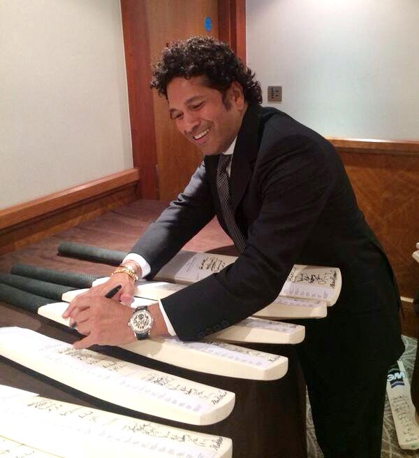 Sachin Tendulkar autographs a few cricket bats