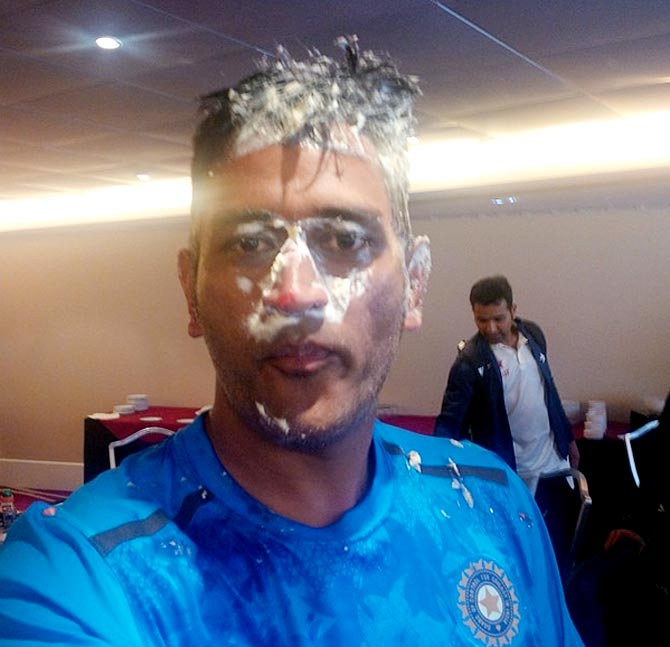 Birthday boy Dhoni under cake-attack!