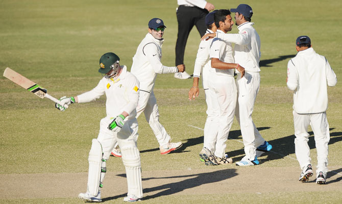 Dhawal Kulkarni of India 'A' celebrates with team-mates after claiming the wicket of Phillip Hughes of Australia 'A'
