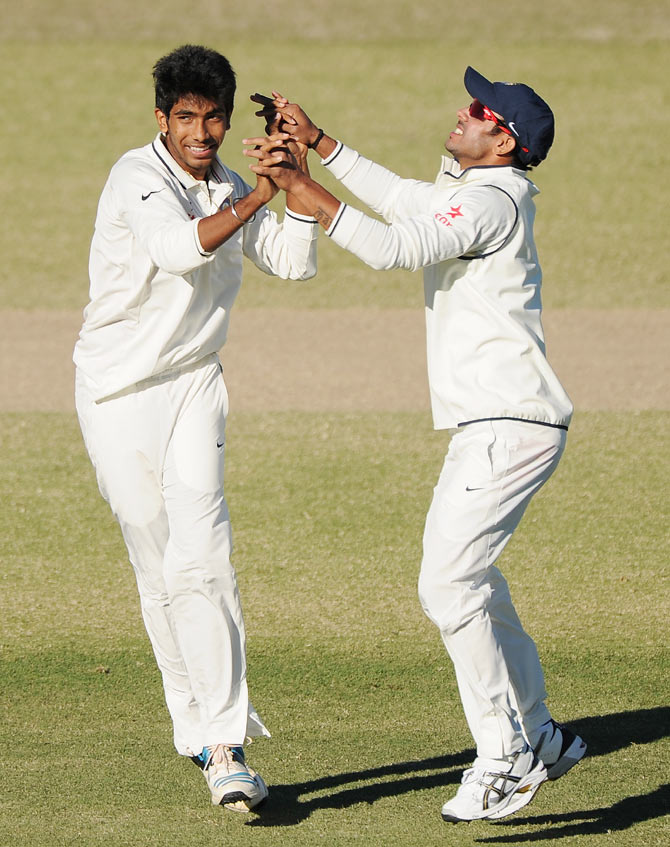 Jasprit Bumrah (left) of India 'A' celebrates after claiming the wicket of Peter Forrest of Australia 'A'
