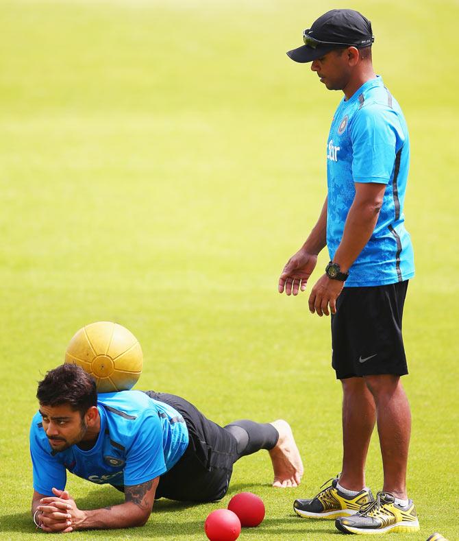 India's Virat Kohli (left) looks on during a India nets session at Trent Bridge on Monday
