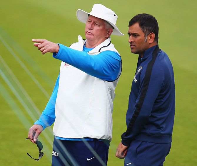 Duncan Fletcher, coach of India, talks to captain MS Dhoni during a India nets session