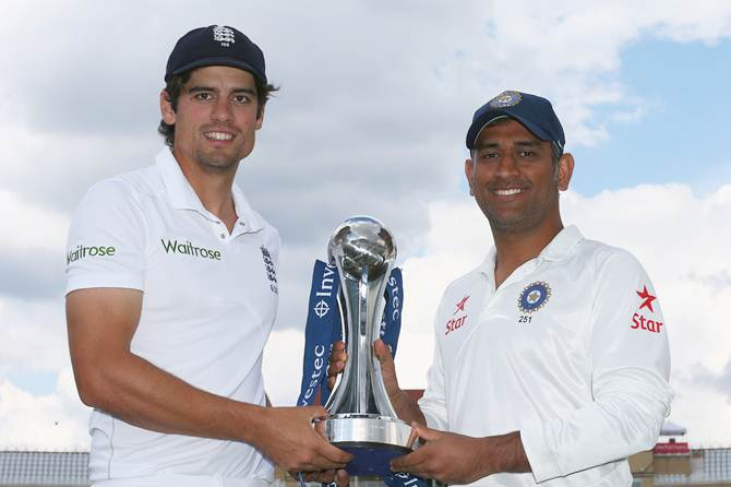 England captain Alastair Cook (left) and Mahendra Singh Dhoni, captain of India, with the Investec trophy ahead of the first Investec Test series at Trent Bridge.