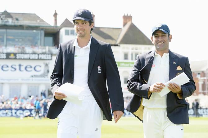 England captain Alastair Cook (left) and Mahendra Singh Dhoni, captain of India, walk out for the toss