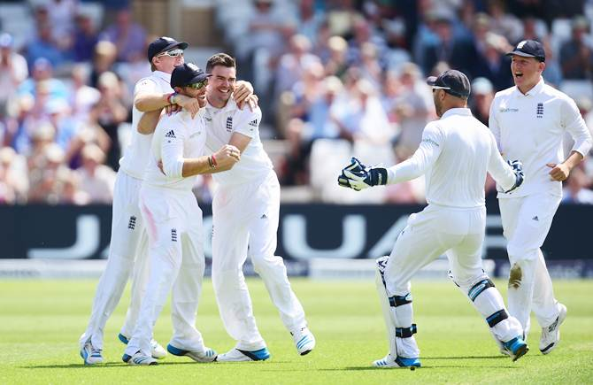 James Anderson celebrates with Ian Bell and Joe Root after dismissing Cheteshwar Pujara