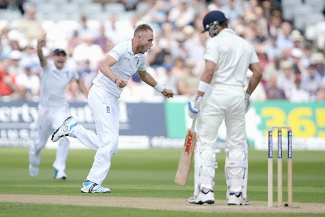 Stuart Broad of England celebrates with Sam Robson after dismissing Virat Kohli
