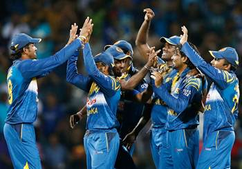 Sri Lanka's captain Angelo Mathews (third from right) and Tillakaratne Dilshan (second from right) celebrate with teammates the dismissal of South Africa's David Miller