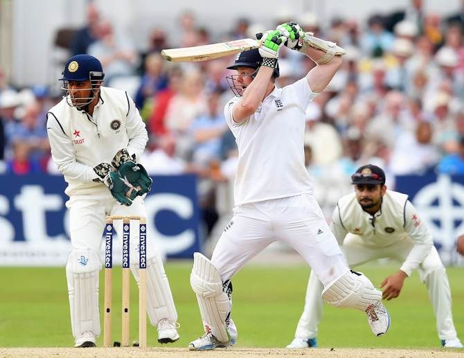 Wicketkeeper Mahendra Singh Dhoni and Virat Kohli, at slips, watch as Sam Robson cuts the ball for a boundary