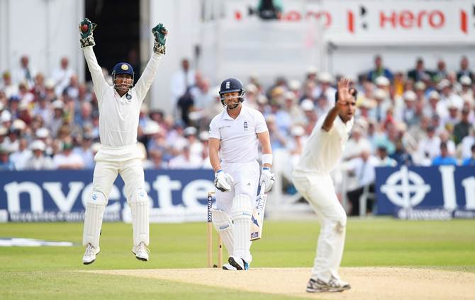 Mahendra Singh Dhoni and Bhuvneshwar Kumar appeal successfully for the wicket of Matt Prior