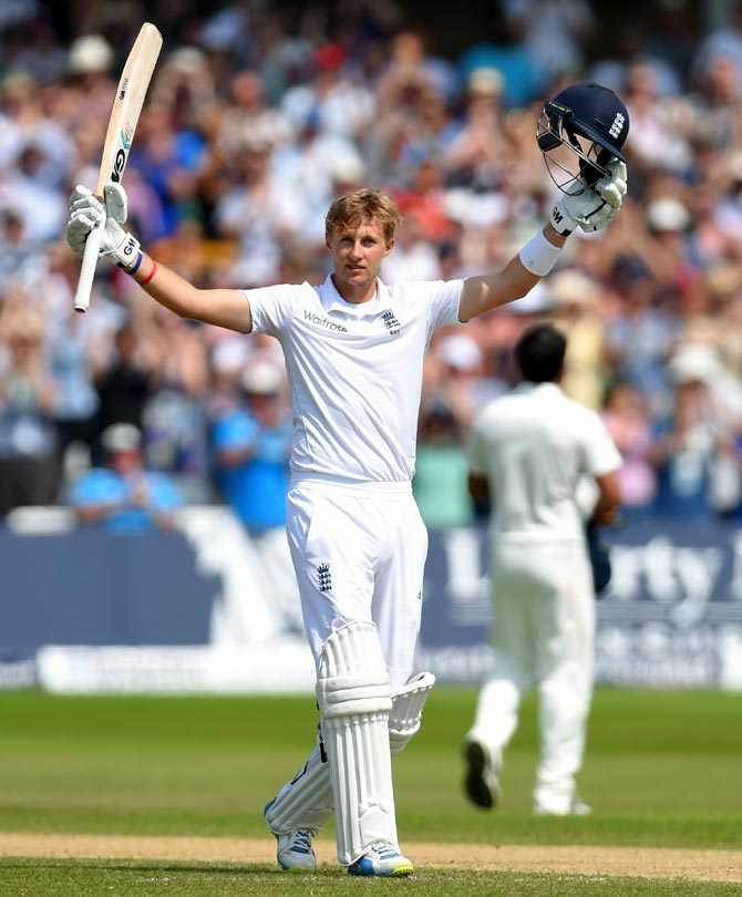Joe Root celebrates after completing his century