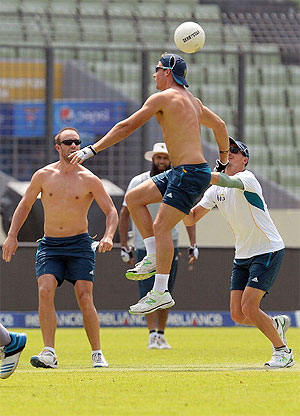 South Africa's Faf du Plessis (centre) and AB de Villiers play a warm-up football game