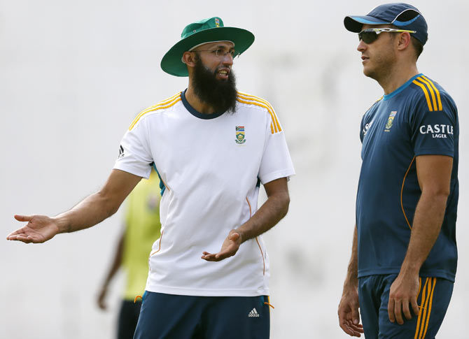 South Africa's Hashim Amla (left) talks with teammate Faf du Plessis during a practice session
