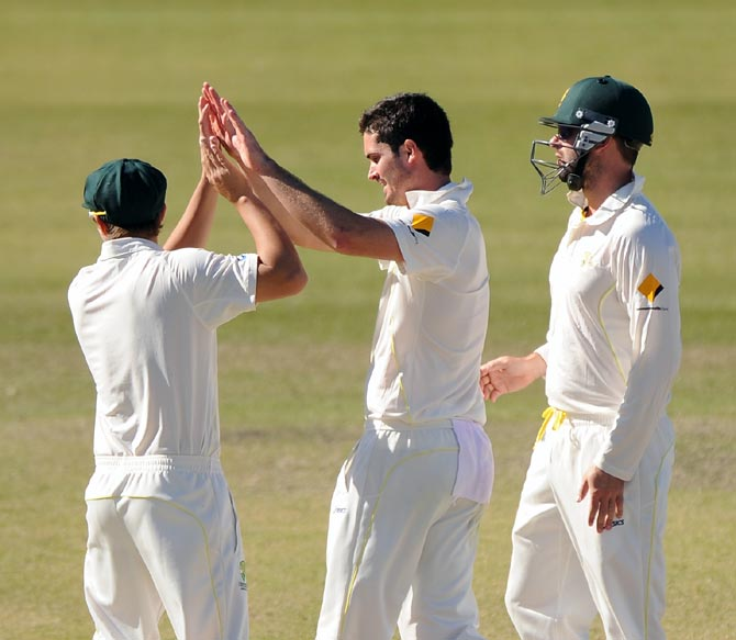 Ben Cutting (centre) of Australia A celebrates a wicket with his team mates