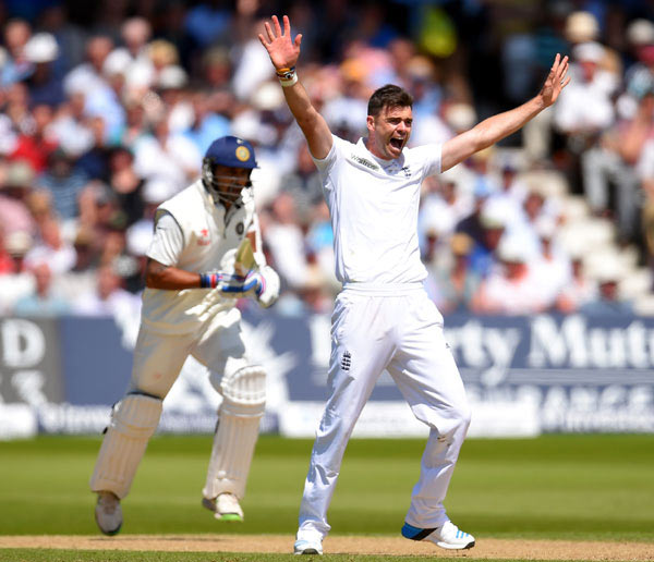 England bowler James Anderson celebrates after trapping India's Murali Vijay (left) lbw