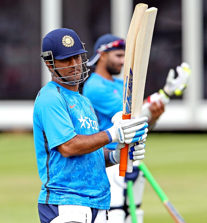 Mahendra Singh Dhoni checks his bats during an India nets session at Lord's in London
