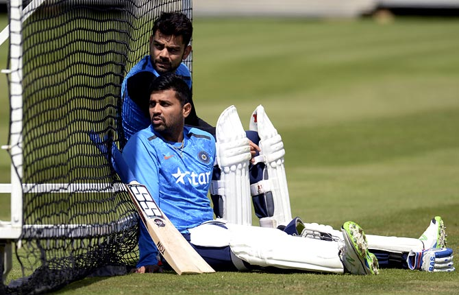 Virat Kohli (left) and Murali Vijay relax during a nets session