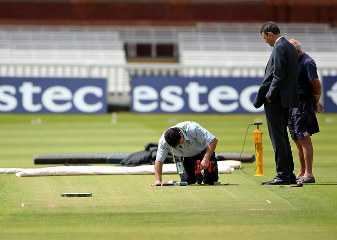Groundstaff work on the pitch at Lord's