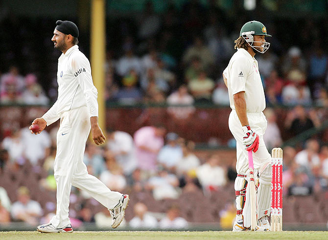 Harbhajan Singh of India walks past Andrew Symonds of Australia on his way back to his bowling mark during day four of the Second Test match between Australia and India at the Sydney Cricket Ground on January 5, 2008
