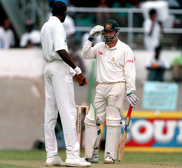 Steve Waugh (right) speaks to Curtley Ambrose