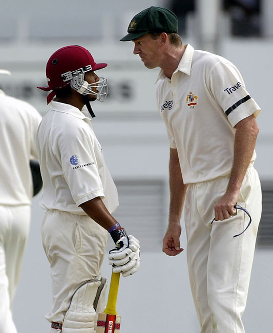 Ramnaresh Sarwan (left) and Glenn McGrath confront each other