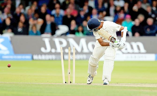 Rahul Dravid of the MCC looks back as he is bowled by Paul Collingwood of Rest of the World during the MCC and Rest of the World match at Lord's Cricket Ground on July 5, 2014